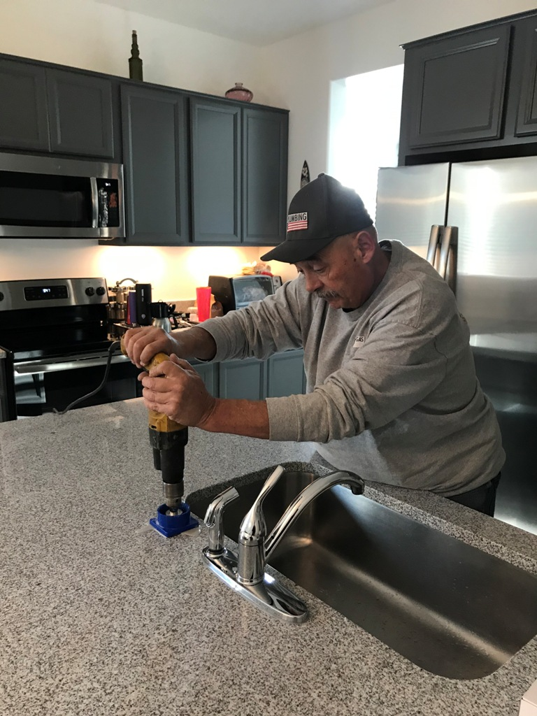 another reason to hire a Professional Plumber Drilling granite countertop for reverse osmosis